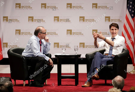 Justin Trudeau, David Axelrod. Canadian Prime Minister Justin Trudeau, right, responds to a question from founder and director, David Axelrod, left, at the University of Chicago Institute of Politics, in Chicago