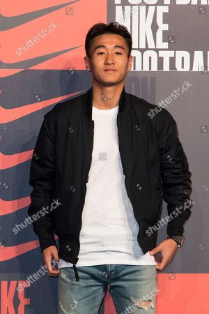 Wei Shihao poses for photographers upon arrival at the Nike Celebrates The Beautiful Game event, in London
