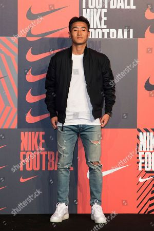 Stock Photo of Wei Shihao poses for photographers upon arrival at the Nike Celebrates The Beautiful Game event, in London