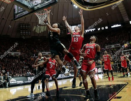 Purdue guard Carsen Edwards (3) shoots after going around Ohio State guard Andrew Dakich (13) during the second half of an NCAA college basketball game in West Lafayette, Ind., . Ohio State won 64-63