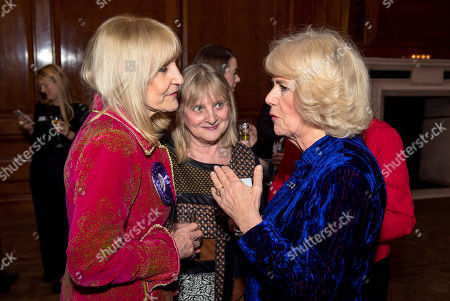 Stock Photo of Camilla Duchess of Cornwall meets Lynn Faulds Wood (left) during a reception for Women in Journalism at The Ned