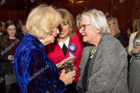 Camilla Duchess of Cornwall meets Eve Pollard (centre) and Lynn Barber (right) during a reception for 'Women in Journalism' at The Ned