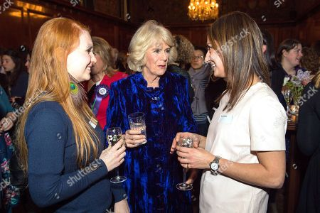 Camilla Duchess of Cornwall meets Sunday Times royal correspondent Roya Nikkhah (right) and Daily Telegraph royal correspondent Hannah Furness (left) during a reception for Women in Journalism at The Ned