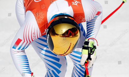 The finish area is reflected in the ski helmet of Wiley Maple of the United States after Men's Downhill training at the 2018 Winter Olympics in Jeongseon, South Korea