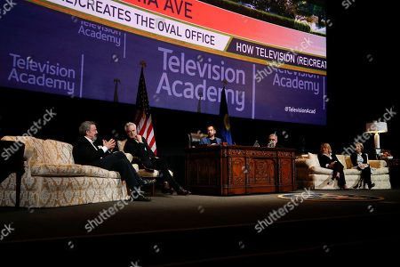 """Thomas Schlamme, Bradley Whitford, Kal Penn, David Mandel, Barbara Hall, Michelle King. From left to right, Thomas Schlamme, Executive Producer, """"The West Wing"""", Bradley Whitford, Actor, """"The West Wing"""", Moderator Kal Penn, Actor, """"Designated Survivor"""" & former White House staffer, David Mandel, Executive Producer and Showrunner, """"Veep"""", Barbara Hall, Creator and Showrunner, """"Madam Secretary"""", and Co-Executive Producer, """"Homeland"""", and Michelle King, Creator, """"The Good Wife"""", """"The Good Fight"""" and """"BrainDead"""" participate in the Television Academy's member event """"Penning Pennsylvania Ave.: How Hollywood (Re)Creates The Oval Office,"""" while sitting on props from the Oval Office set of the television show """"The West Wing"""" including a Resolute desk replica on at the Saban Media Center at the Television Academy in North Hollywood Calif"""