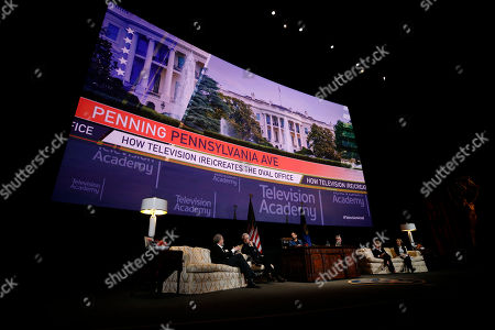 """Stock Image of Thomas Schlamme, Bradley Whitford, Kal Penn, David Mandel, Barbara Hall, Michelle King. From left to right, Thomas Schlamme, Executive Producer, """"The West Wing"""", Bradley Whitford, Actor, """"The West Wing"""", Moderator Kal Penn, Actor, """"Designated Survivor"""" & former White House staffer, David Mandel, Executive Producer and Showrunner, """"Veep"""", Barbara Hall, Creator and Showrunner, """"Madam Secretary"""", and Co-Executive Producer, """"Homeland"""", and Michelle King, Creator, """"The Good Wife"""", """"The Good Fight"""" and """"BrainDead"""" participate in the Television Academy's member event """"Penning Pennsylvania Ave.: How Hollywood (Re)Creates The Oval Office,"""" while sitting on props from the Oval Office set of the television show """"The West Wing"""" including a Resolute desk replica on at the Saban Media Center at the Television Academy in North Hollywood Calif"""
