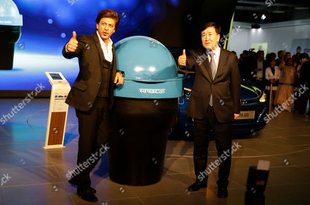 Shahrukh Khan, YK Koo. Bollywood super star Shahrukh Khan, left, and Hyundai Motor India Ltd Managing Director and Chief Executive Officer YK Koo pose in front of 'Swachh Can' a portable bin at the Auto Expo in Greater Noida, near New Delhi, India, . The portable bin has been made under Hyundai's corporate social responsibility pillar in support of Indian government's Clean India Mission. The biennial automobile exhibition opens to public Friday and runs till Feb.14