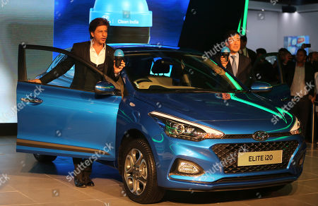 Shahrukh Khan, YK Koo. Bollywood super star Shahrukh Khan, left, and Hyundai Motor India Ltd Managing Director and Chief Executive Officer YK Koo hold 'Swachh Can' a portable bin, as they pose near a Hyundai Elite i20 car at the Auto Expo in Greater Noida, near New Delhi, India, . The portable bin has been made under Hyundai's corporate social responsibility pillar in support of Indian government's Clean India Mission. The biennial automobile exhibition opens to public Friday and runs till Feb.14