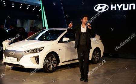 Bollywood super star Shahrukh Khan speaks during the launch of 'Swachh Can' a portable bin at the Auto Expo in Greater Noida, near New Delhi, India, . The portable bin has been made under Hyundai's corporate social responsibility pillar in support of Indian government's Clean India Mission. The biennial automobile exhibition opens to public Friday and runs till Feb.14