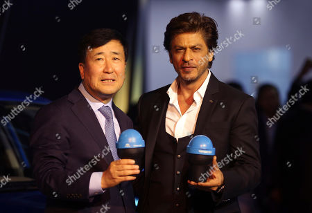 Shahrukh Khan, YK Koo. Bollywood super star Shahrukh Khan, right, and Hyundai Motor India Ltd Managing Director and Chief Executive Officer YK Koo, left, hold 'Swachh Can' a portable bin, as they pose at the Auto Expo in Greater Noida, near New Delhi, India, . The portable bin has been made under Hyundai's corporate social responsibility pillar in support of Indian government's Clean India Mission. The biennial automobile exhibition opens to public Friday and runs till Feb.14