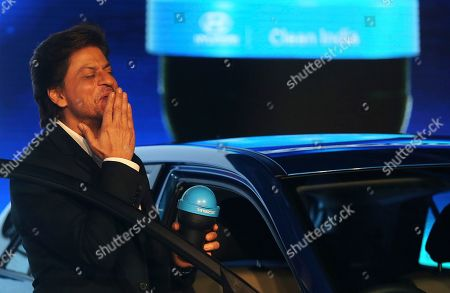 Bollywood superstar Shahrukh Khan blows a kiss towards his fans as he holds a 'Swachh Can' a portable bin launched at the Auto Expo in Greater Noida, near New Delhi, India, . The portable bin has been made under Hyundai's corporate social responsibility pillar in support of Indian government's Clean India Mission. The biennial automobile exhibition opens to public Friday and runs till Feb.14