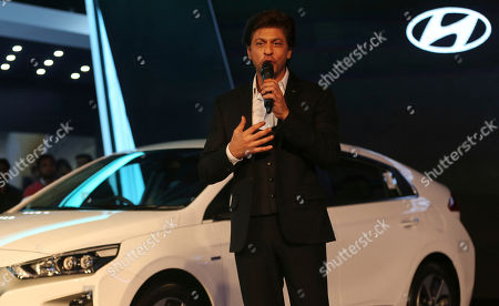 Bollywood superstar Shahrukh Khan speaks during the launch of 'Swachh Can' a portable bin at the Auto Expo in Greater Noida, near New Delhi, India, . The portable bin has been made under Hyundai's corporate social responsibility pillar in support of Indian government's Clean India Mission. The biennial automobile exhibition opens to public Friday and runs till Feb.14