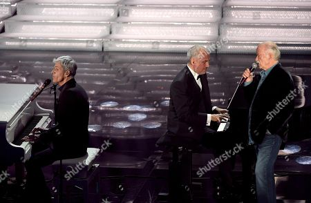 Stock Photo of Sanremo Festival artistic director Claudio Baglioni (L), Italian musician Danilo Rea (C) and Italian singer Gino Paoli (R) perform on stage during the 68th Sanremo Italian Song Festival at the Ariston theatre in Sanremo, Italy, 08 February 2018. The 68th edition of the television song contest runs from 06 to 10 February.