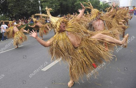 Stock Photo of Performers of the ethnic Tujia dance to celebrate harvest and phallism