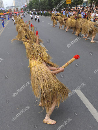 Performers of the ethnic Tujia dance to celebrate harvest and phallism