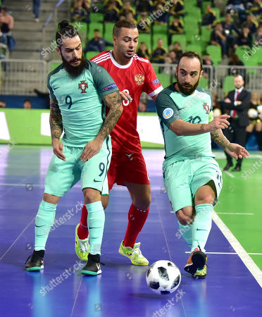 Ricardinho (R) and Joao Matos (L) from Portugal in action against Eder Lima from Russia during the UEFA Futsal EURO 2018 semi final match between Russia and Portugal at Arena Stozice in Ljubljana, Slovenia, 08 February 2018.