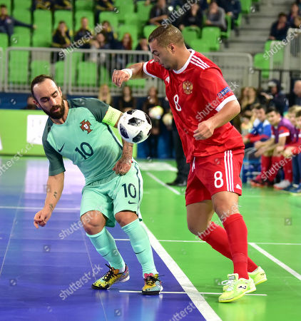 Ricardinho (L) from Portugal in action against Eder Lima from Russia during the UEFA Futsal EURO 2018 semi final match between Russia and Portugal at Arena Stozice in Ljubljana, Slovenia, 08 February 2018.