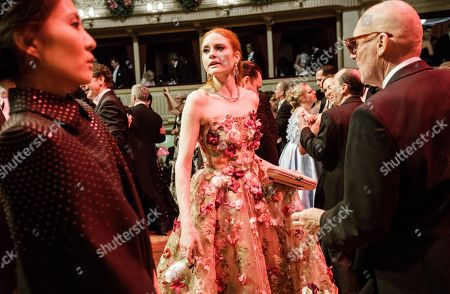 German model Barbara Meier (C) and Swiss photographer Michel Comte (R) dance during the traditional 62nd Vienna Opera Ball at the State Opera in Vienna, Austria, 08 February 2018.