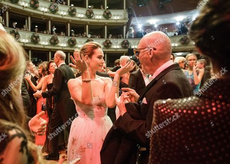 British actress Lily James (L) and Swiss photographer Michel Comte (R) dance during the traditional 62nd Vienna Opera Ball at the State Opera in Vienna, Austria, 08 February 2018.