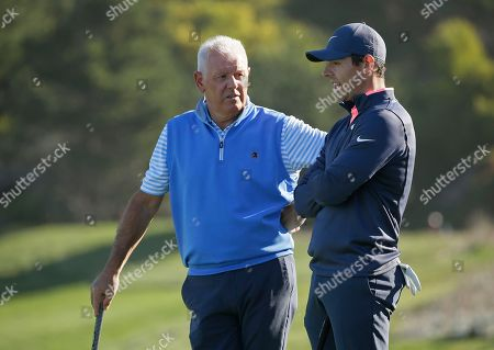 Rory McIlroy, Gerry McIlroy. Rory McIlroy, right, of Northern Ireland, talks with his father Gerry McIlroy, left, while waiting to putt on the second green of the Spyglass Hill Golf Course during the first round of the AT&T Pebble Beach National Pro-Am golf tournament, in Pebble Beach, Calif