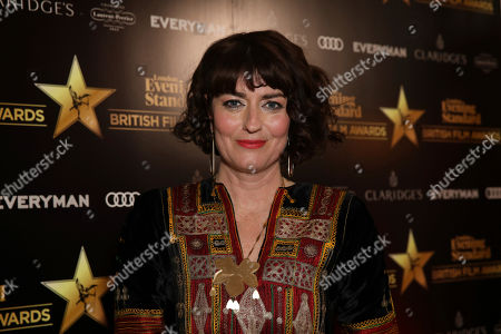 Actress Anna Chancellor poses for photographers on arrival