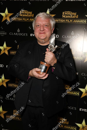 Actor Simon Russell Beale poses for photographers after receiving the award for 'Best Supporting Actor' for his role in the Film 'The Death of Stalin'