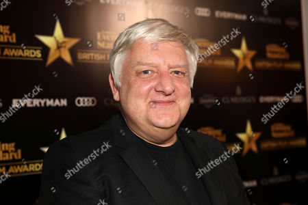 Actor Simon Russell Beale poses for photographers on arrival