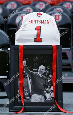 Stock Image of A tribute for longtime Utah donor, supporter and billionaire philanthropist Jon M. Huntsman Sr., who died last week, is shown on his seat before an NCAA college basketball game between Stanford and Utah, in Salt Lake City