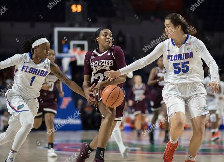Tameria Johnson, Stephanie Brower, Bre'Amber Scott. Florida guard Tameria Johnson (1) and forward Stephanie Brower (55) knock the ball away from Mississippi State guard Bre'Amber Scott (23) during the second half of an NCAA college basketball game in Gainesville, Fla