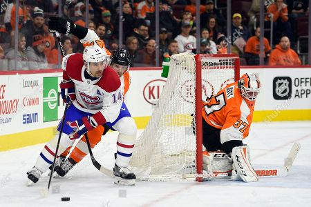 Brian Elliott, Tomas Plekanec, Andrew MacDonald. Philadelphia Flyers goalie Brian Elliott (37) looks for the puck as Montreal Canadiens' Tomas Plekanec (14) skates around the net in front of Andrew MacDonald during the third period of an NHL hockey game, in Philadelphia. The Flyers won 5-3