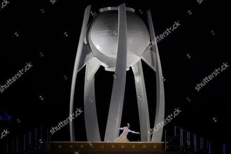 South Korean Olympic figure skating champion Yuna Kim performs before lighting the Olympic flame during the opening ceremony of the 2018 Winter Olympics in Pyeongchang, South Korea