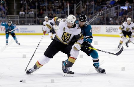 Joakim Ryan, James Neal. San Jose Sharks' Joakim Ryan, right, defends against Vegas Golden Knights' James Neal during the first period of an NHL hockey game, in San Jose, Calif