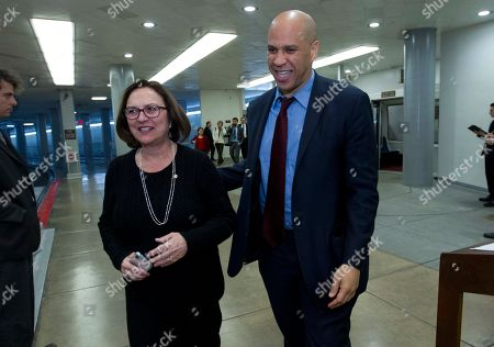 Cory Booker, Deb Fischer. Sen. Cory Booker D-N.J., accompanied by Sen. Deb Fischer, R-Neb., walk to the senate chamber, at Capitol Hill in Washington