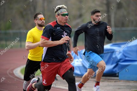 Jose Lobaton, Ender Inciarte, Mauro Conde. Professional baseball players Jose Lobaton, center, Ender Inciarte, left, and Mauro Conde work out at the Coach Tom Shaw Performance camp, in Lake Buena Vista, Fla