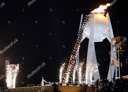 Yuna Kim lights Olympic flame during the opening ceremony of the 2018 Winter Olympics in Pyeongchang, South Korea