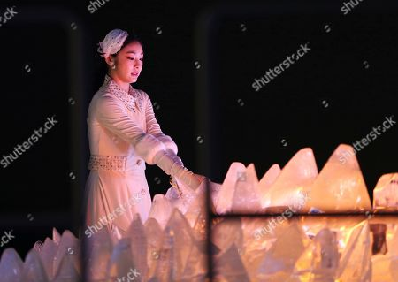South Korean Olympic figure skating champion Yuna Kim lights the Olympic cauldron during the opening ceremony of the 2018 Winter Olympics in Pyeongchang, South Korea