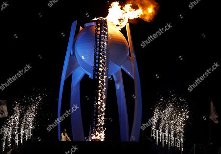 Yuna Kim, former South Korean figure skater lights the Olympic cauldron during the opening ceremony of the 2018 Winter Olympics in Pyeongchang, South Korea