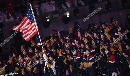 Team United States of America with US flag bearer Erin Hamlin enter the stadium during the Opening Ceremony of the PyeongChang 2018 Olympic Games at the Olympic Stadium, Pyeongchang county, South Korea, 09 February 2018.