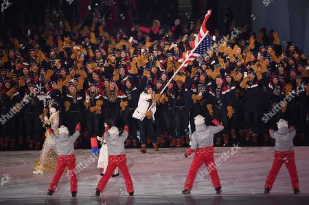 Team United States of America with US flag bearer Erin Hamlin enter the stadium greeted by dancing Olympic volunteers during the Opening Ceremony of the PyeongChang 2018 Olympic Games at the Olympic Stadium, Pyeongchang county, South Korea, 09 February 2018.