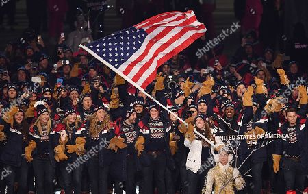 Team United States of America with US flag bearer Erin Hamlin as they march in the stadium during the Opening Ceremony of the PyeongChang 2018 Olympic Games at the Olympic Stadium, Pyeongchang county, South Korea, 09 February 2018.