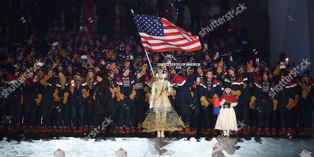 Team United States of America with US flag bearer Erin Hamlin as they enter the stadium during the Opening Ceremony of the PyeongChang 2018 Olympic Games at the Olympic Stadium, Pyeongchang county, South Korea, 09 February 2018.