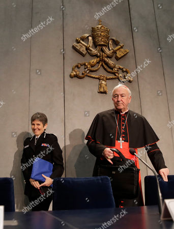 Cressida Rose Dick, Commissioner of the Metropolitan Police in London, left, and cardinal Vincent Nichols arrive for a press conference following the Santa Marta Group reunion, a conference promoted by Pope Francis between police chiefs and bishops aimed to fight against human trafficking and modern slavery, at the Vatican