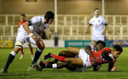 England U20's vs Wales U20?s. England's Gabriel Ibitoye tackles Ben Thomas of Wales