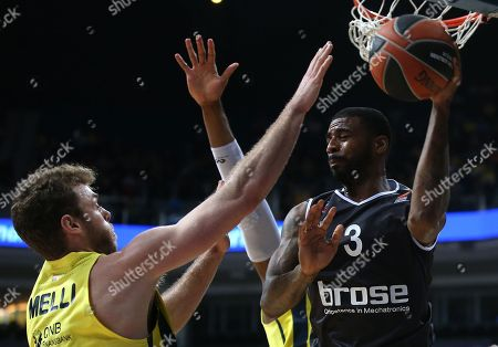 Stock Image of Nicolo Melli (L) of Fenerbahce in action against Dorell Wright (R) of Bamberg during the Euroleague basketball match between Fenerbahce Dogus and Brose Bamberg in Istanbul, Turkey, 09 February 2018.