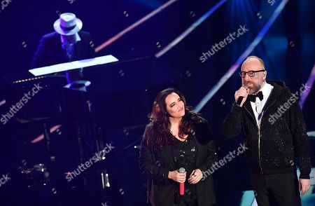 Italian singer Mario Biondi (R) with Bazilian musicians Ana Carolina (C) and Daniel Jobim (L) perform on stage during the 68th Sanremo Italian Song Festival at the Ariston theatre in Sanremo, Italy, 09 February 2018. The festival will run from 06 to 10 February.