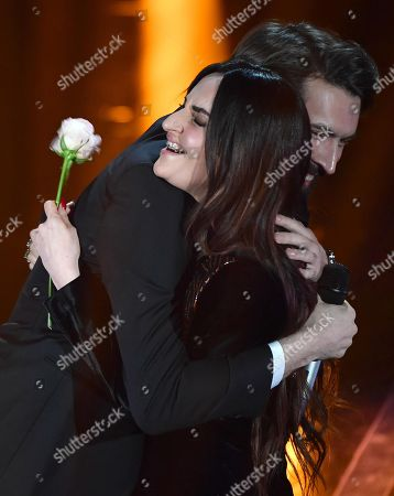 Italian singers Giovanni Caccamo (L) and Arisa (R) perform on stage during the 68th Sanremo Italian Song Festival at the Ariston theatre in Sanremo, Italy, 09 February 2018. The 68th edition of the television song contest runs from 06 to 10 February.