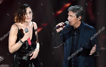 Italian singer Luca Barbarossa (R) and Italian actress Anna Foglietta perform on stage during the 68th Sanremo Italian Song Festival at the Ariston theatre in Sanremo, Italy, 09 February 2018. The 68th edition of the television song contest runs from 06 to 10 February.