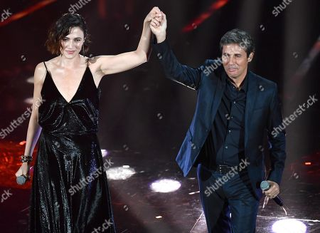 Stock Image of Italian singer Luca Barbarossa (R) and Italian actress Anna Foglietta perform on stage during the 68th Sanremo Italian Song Festival at the Ariston theatre in Sanremo, Italy, 09 February 2018. The 68th edition of the television song contest runs from 06 to 10 February.