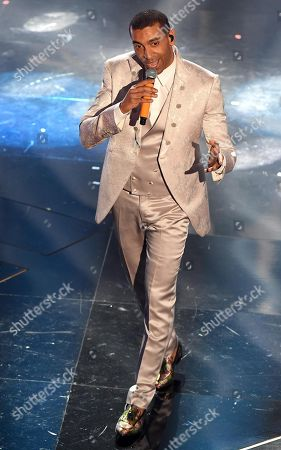 Stock Picture of Italian singer Mudimbi performs on stage during the 68th Sanremo Italian Song Festival at the Ariston theatre in Sanremo, Italy, 09 February 2018.The festival will run from 06 to 10 February.