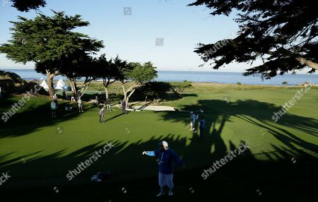 Gerry McIlroy putts on the 10th green of the Monterey Peninsula Country Club Shore Course during the second round of the AT&T Pebble Beach National Pro-Am golf tournament, in Pebble Beach, Calif